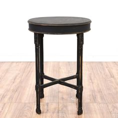 This end table is featured in a solid wood with a distressed black finish. This cottage chic style side table has a drum top, x stretchers and carved legs. Perfect for holding fresh flowers! #cottagechic #tables #endtable #sandiegovintage #vintagefurniture