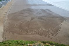 artist Simon Beck (previously) trudges across sand or through knee-high snow to create massive geometric drawings left behind in his footprints. From sandy expanses on the shore of New Zealand to frigid outlooks in the Swiss Alps, any pristine surface that stretches for hundreds of meters can work as a suitable canvas for Beck's designs.