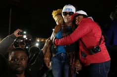 Lesley McSpadden (second from right), Michael Brown's mother, is comforted outside the Ferguson police department as St. Louis County Prosecutor Rober...