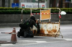 A photographer takes a photograph as soldiers clash with anti-government Red Shirt protesters in Bangkok May 17, 2010.