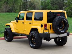 2015 Jeep Wrangler Unlimited Sahara in Baja Yellow! Equipped with a lift kit and custom tires and wheels. #jeepwrangler