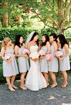 Bridesmaids in short, strapless, gray J.Crew bridesmaid dresses carried pink peony bouquets