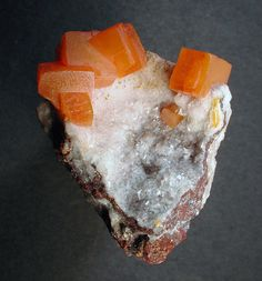Wulfenite crystals on matrix with Calcite / Erupción Mine, Chihuahua, Mexico