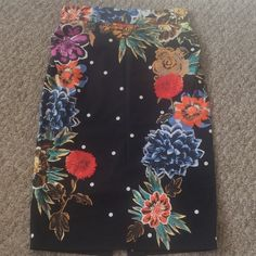 Anthropologie Baraschi Peppering skirt size 0 Anthropologie by yoana baraschi peppering skirt in size 0. It is fully lined, and the skirt id 97% cotton and 3% spandex so it's a bit stretchy. Has an invisible zipper and a back slit, plus ruching on the sides. Has been worn once and stored in a smoke/pet free home. Anthropologie Skirts Pencil