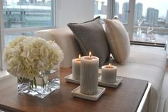 I love the end table decor.. The flowers and candles. #homedecor