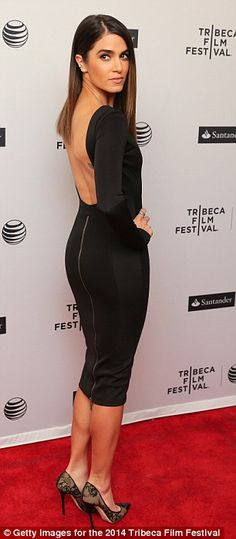 Best dressed @ 2014 Tribeca Film Festival | Nikki Reed in a black Boulee dress with a open back paired with Jimmy Choo lace pumps and clutch