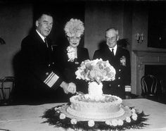 """The celebration of the Bikini Atoll experiment in 1946 with an """"atomic cake""""."""