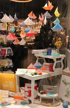 Origami boats in our summer window display for the weekends of Yacht Races. #sailboat #diymobile #origami