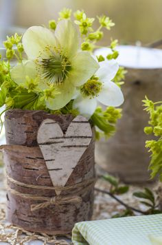 Birch bark heart decorated vase with ranunculus. More images like this at flowerpress.cz