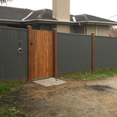 Colorbond fencing with timber gate and posts. Timber Gates, Timber Fencing, Wooden Gates, Pool Fence, Backyard Fences, Garden Fencing, Corrugated Metal Fence, Timber Posts, Privacy Fence Designs