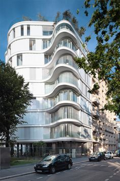 ECDM has added a nine-storey tower with an undulating glass form to a row of housing blocks in Paris