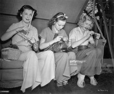 Patricia Wilder, Anne Shirley, and Lucille Ball, (left to right), are the three young ladies studiously applying themselves to their 'knit one purl one' between scenes on the RKO Radio lot in Hollywood.