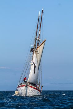 Tall Ship off Fairhead Northern Ireland by mijola37