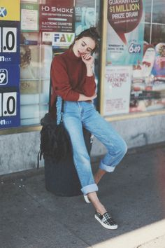 Rolled up boyfriend jeans, burgundy top and slip on shoes.