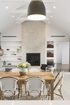 #fireplace #stonefireplace #whitebuiltinshelving #rusticchairs #whitebeams