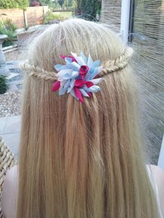 Two inverted fishtail braids joined in the middle with a handmade ribbon korker flower from Www.brionisboutique.co.uk ♥