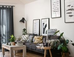 White living room with art wall