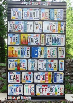 The Serenity Prayer in license plate letters... AWESOME ღ - This is one of the most amazing things I have ever seen! Can you imagine driving down the street and seeing this in someone's front yard? I would have to stop, knock on the door and tell them what a wonderful thing they have created.