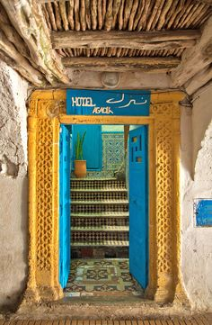 Beautiful teals and crisp yellows line the doorway at the entrance to the Hotel Agadir in Morocco.