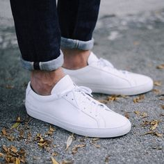 White sneakers are a crucial Summer item. Pair them with light wash denim  for a warm 58b843a55