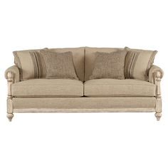 Showcasing exposed carved arms and linen-hued upholstery, this charming sofa adds a lovely touch to your living room or den.    Product...