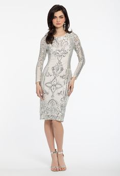 Make an elaborate entrance in this detailed wedding guest dress! This intricate style packs all the gorgeous sequin detail into a short silhouette, featuring a scoop neck, modest long sleeves and a flattering fitted bodice. Complete your look with a glitter bag and lucite satin pumps. #CamilleLaVie