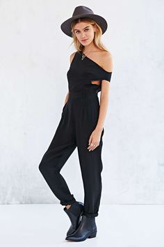 """Maurie & Eve: Trigger Cutout Jumpsuit in  """"Black"""" / """"Silky, printed, lightweight jumpsuit, from Maurie & Eve, topped with a plunge neckline. Complete with elastic detailing along the waist for a snug fit and finished with an open back + cutout detailing."""" / $279.00"""