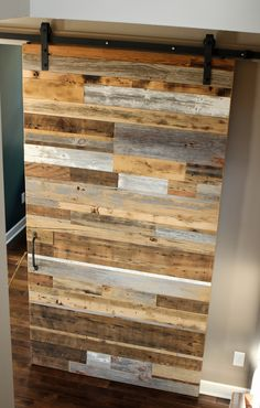 Signature Mismatched Reclaimed Sliding Barn Door Featured in the Parade of Homes, MN