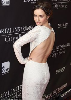 Lily Collins showed quite a bit of skin as she attended the Canadian premiere of The Mortal Instruments: City Of Bones in Toronto, Canada on Thursday