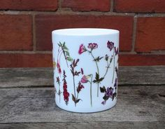 Alice has designed a range of both China and Enamel mugs (see separate listings for the Enamel range) with her illustrations. This design features a rainbow of flowers from red through to blue. The design includes a red poppy, calendula, honeysuckle, sweet peas, snapdragons, red campion, clover, foxglove, lavender, alkanet, cornflower and more.  A greeting card with the same flowers can be found here: https://www.etsy.com/uk/listing/509417258/rainbow-of-flowers-c...