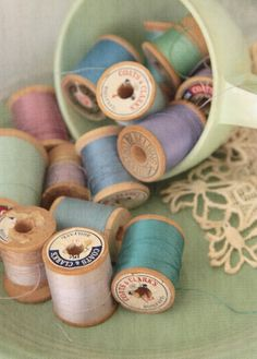 thread on wooden spools