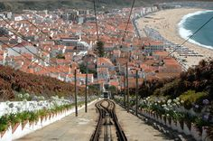 Nazare Village, Portugal  Wonderful village to visit - you can drive up to the top or take a tram!  Beautiful views!