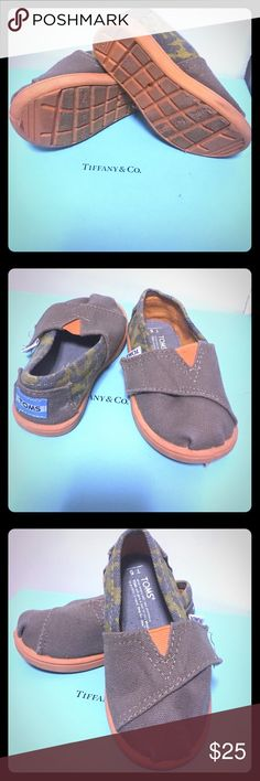 Toms baby boy shoes Tons toddler boy shoes. Brown with orange and camouflage on the side. Soles show light signs of wearing, excellent condition. This is a 5T, and they are unisex but I bought them for my son. Please refer to pictures for more info. TOMS Shoes Moccasins