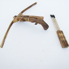 Wooden Crossbow with Quiver and Pack of 3 Arrows DP Brakes http://www.amazon.com/dp/B007IX1O0M/ref=cm_sw_r_pi_dp_cun-tb0T1V8YY