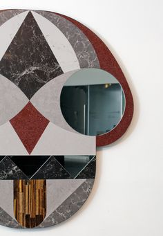 Mirror designed to resemble an animal mask by Jamie Hayón.