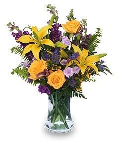Included in This Arrangement    Gathering Vase  Foliage: Sword Fern, Leather Leaf  Yellow Roses  Yellow Asiatic Lilies  Purple Stock  Lavender Mini Carnations  Purple Sinuata Statice