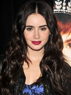 Lily Collins' top 10 hair and makeup looks: promoting Mirror, Mirror, 2012 http://beautyeditor.ca/2013/10/02/lily-collins-makeup-and-hair/