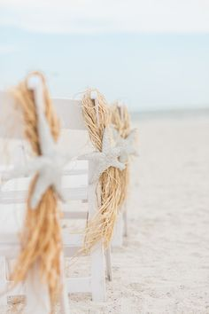 Beach wedding ceremony aisle marker idea - straw and starfish {Rising Lotus Photography}