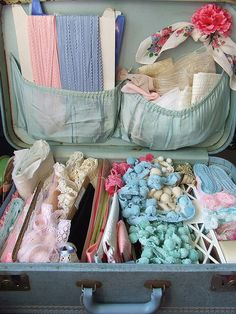 Vintage suitcase filled with sewing supplies