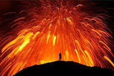 Photographer Skarphéðinn Þráinsson on the edge of the crater at the erupting volcano in Fimmvörðuháls, Iceland