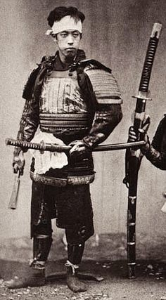 A Samurai next to an odachi, which means big or great sword. This example of an odachi is probably 150cm to 165cm long. It also looks like he is also holding a Tessen or fan. Tessen were real fans although there are many examples of them being a short iron club made to look like a folded fan. If that was the case then they could be used for self defence. http://www.jujitsumelbourne.com.au/jiu-jitsu-melbourne-blog/category/ju%20jitsu