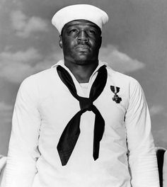 """Doris """"Dorie"""" Miller was a cook in the United States Navy and the first African American to be awarded the Navy Cross Medal. Miller was awarded the medal for his bravery during the attack on Pearl Harbor. Later in the war, Dorie and 643 others were killed when their ship, the USS Liscome Bay, was torpedoed by a Japanese submarine on November 23, 1943."""