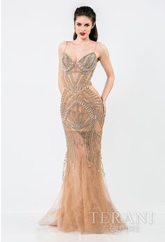 sultry corset   inspired gown with lace underlay and deco inspired pearl and rhinestone   embellished body, the dress is finished with delicate spaghetti straps and   flared hem