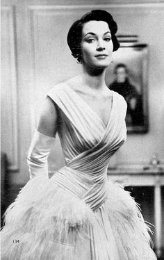 1953 British actress Jean Lodge wearing white draped chiffon gown adorned with maribou feathers