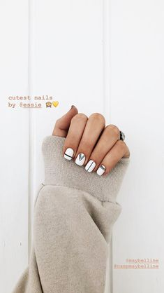 For a minimalist take on striped nail art, cross your white nails with single black lines. See more at NailCentric. Classy Nails, Stylish Nails, Trendy Nails, Cute Nails, Cute Simple Nails, Pink Nails, Gel Nails, Nagellack Design, Minimalist Nails