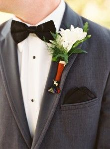 Velvet bowtie, sheer black pocket square, gray tuxedo, simple white boutonniere.  Photo by Adam Barnes.