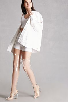 A pair of clear over-the-knee boots featuring a full length back zipper closure, clear lucite block heel, and a pointed toe. This is an independent brand and not a Forever 21 branded item.