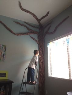 Instant Tree from butcher or kraft paper. Would work for palm tree too. If we ever get artwork for our flower wall we can reuse the flowers for a tree instead!