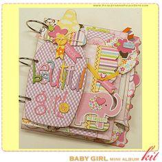 paisleysandpolkadots.com: baby boy and baby girl mini albums with instructions (via scrapclubs.com)