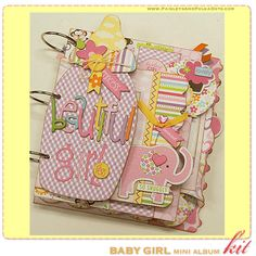 paisleysandpolkadots.com: baby boy and baby girl mini albums with instructions (via scrapclubs.com)